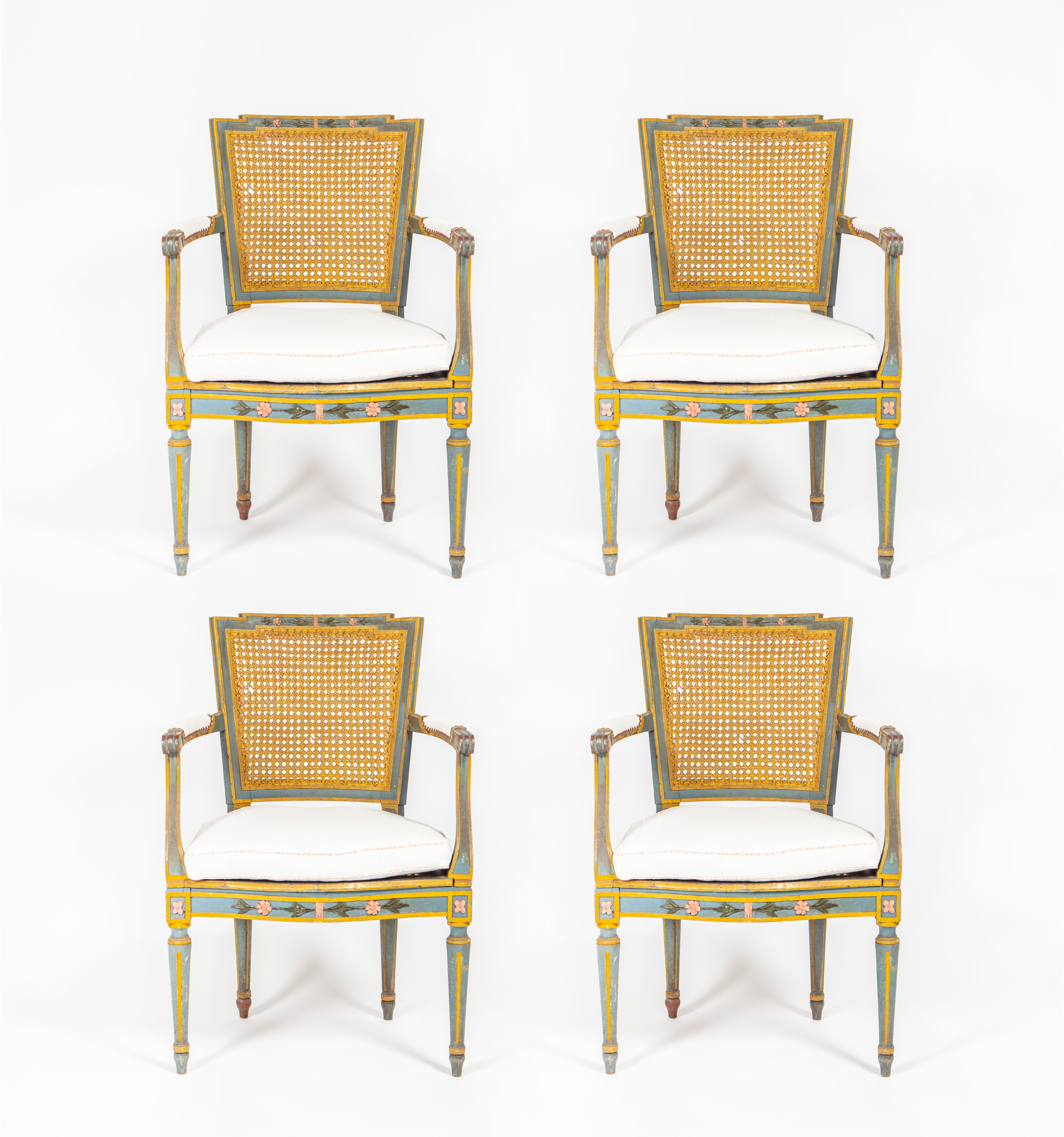 A set of four French painted salon chairs with caned backs and seats, Circa 1780