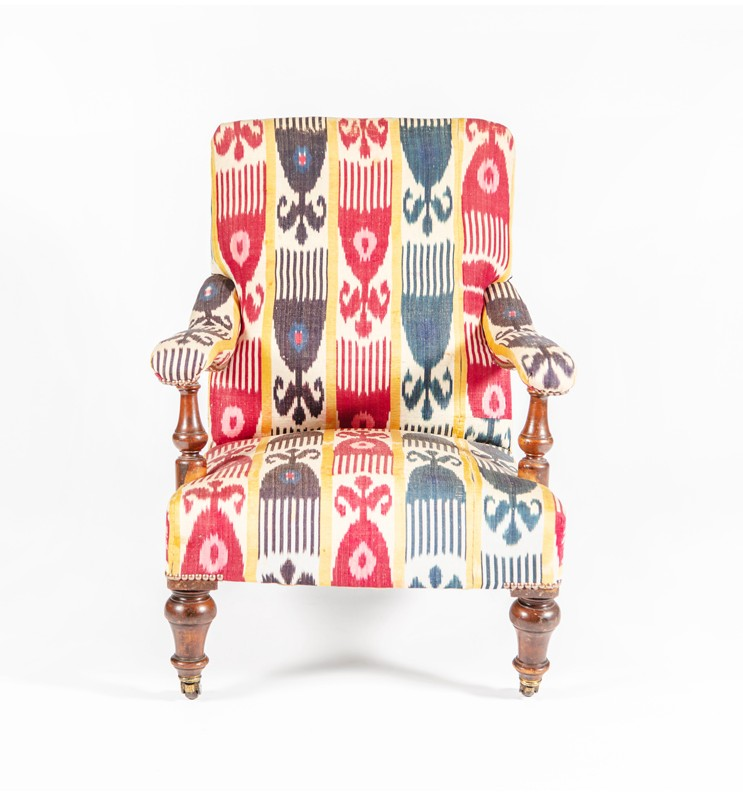 A Victorian open armchair upholstered in vintage ikat, Circa 1860