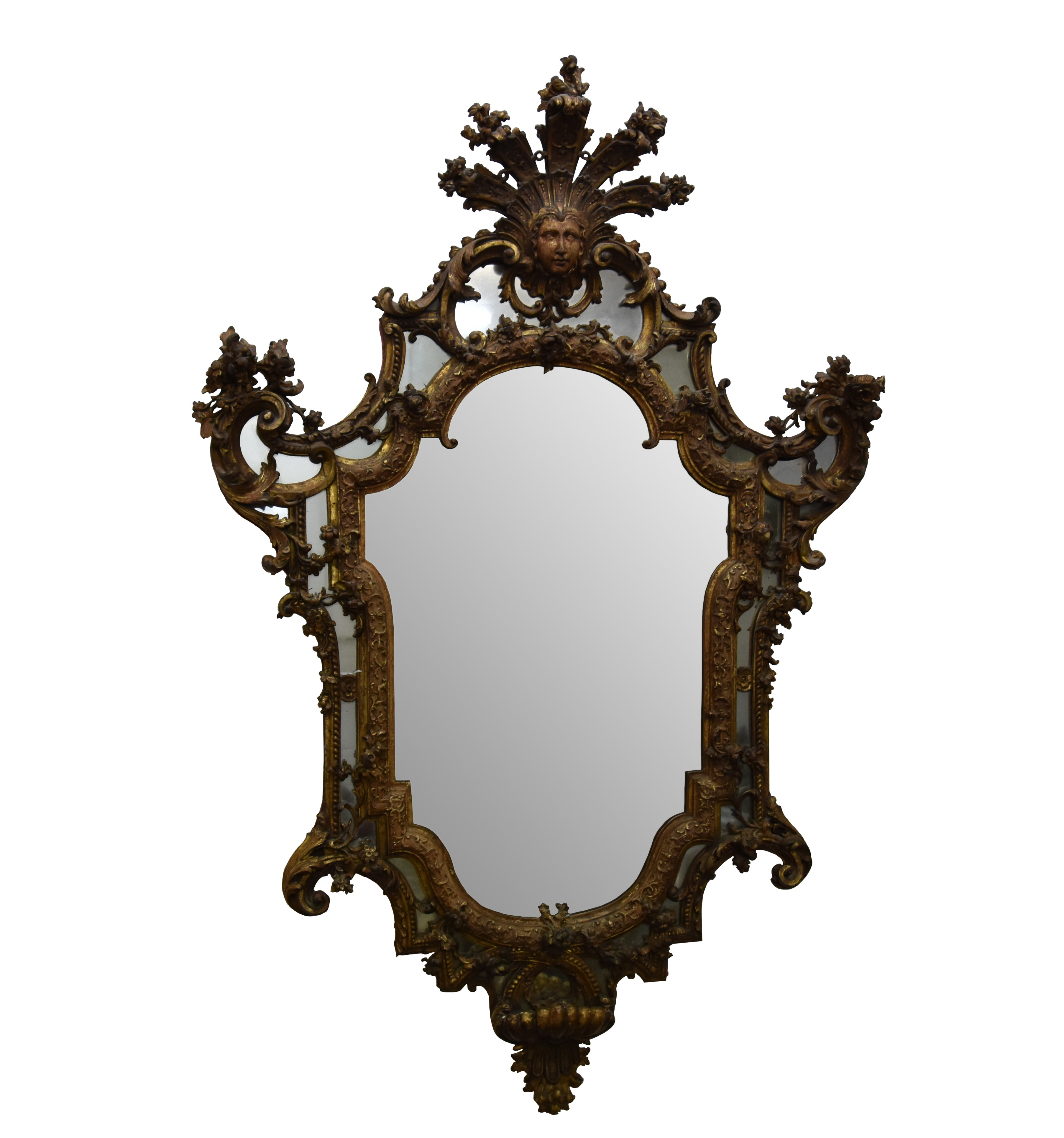A French early 18th century Regence carved giltwood wall mirror, Circa 1745