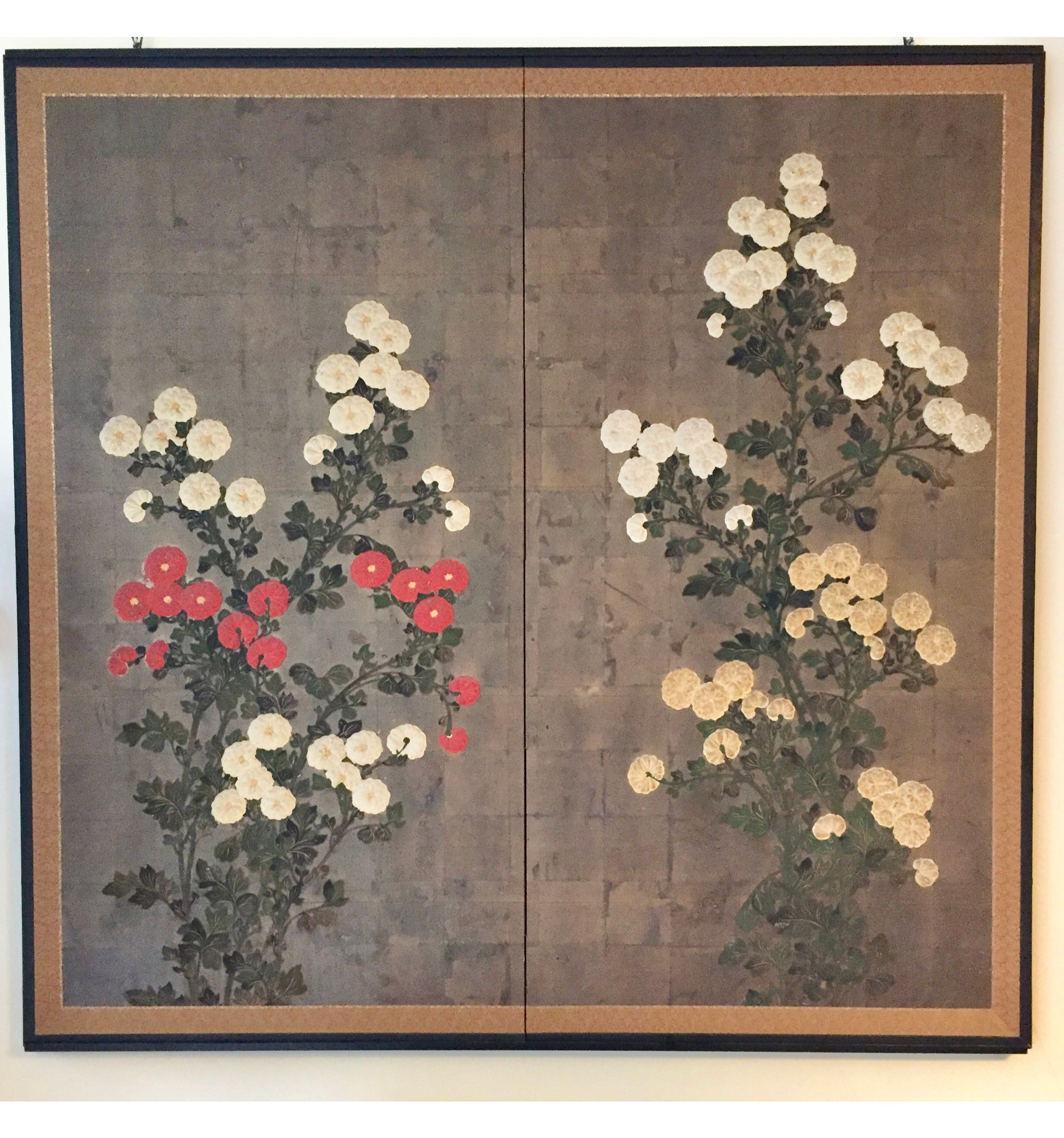 A Japanese Edo Period two fold screen decorated with white and crimson chrysanthemums, Circa 1840
