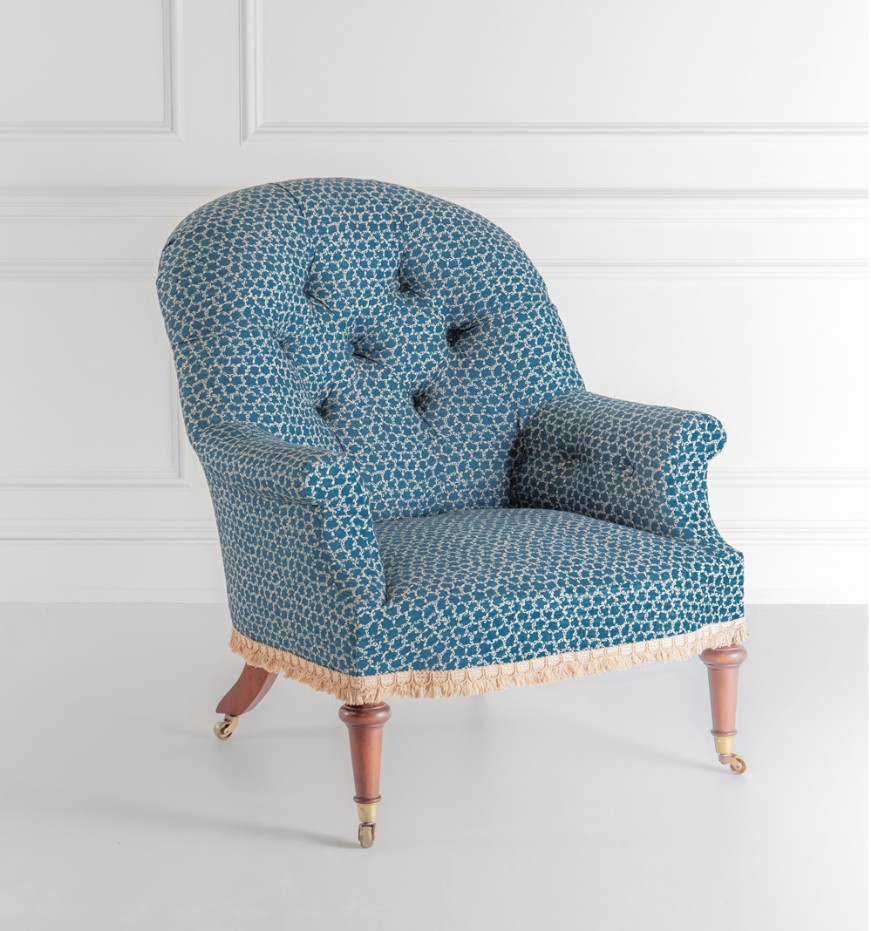 Armchair with deep buttoned back