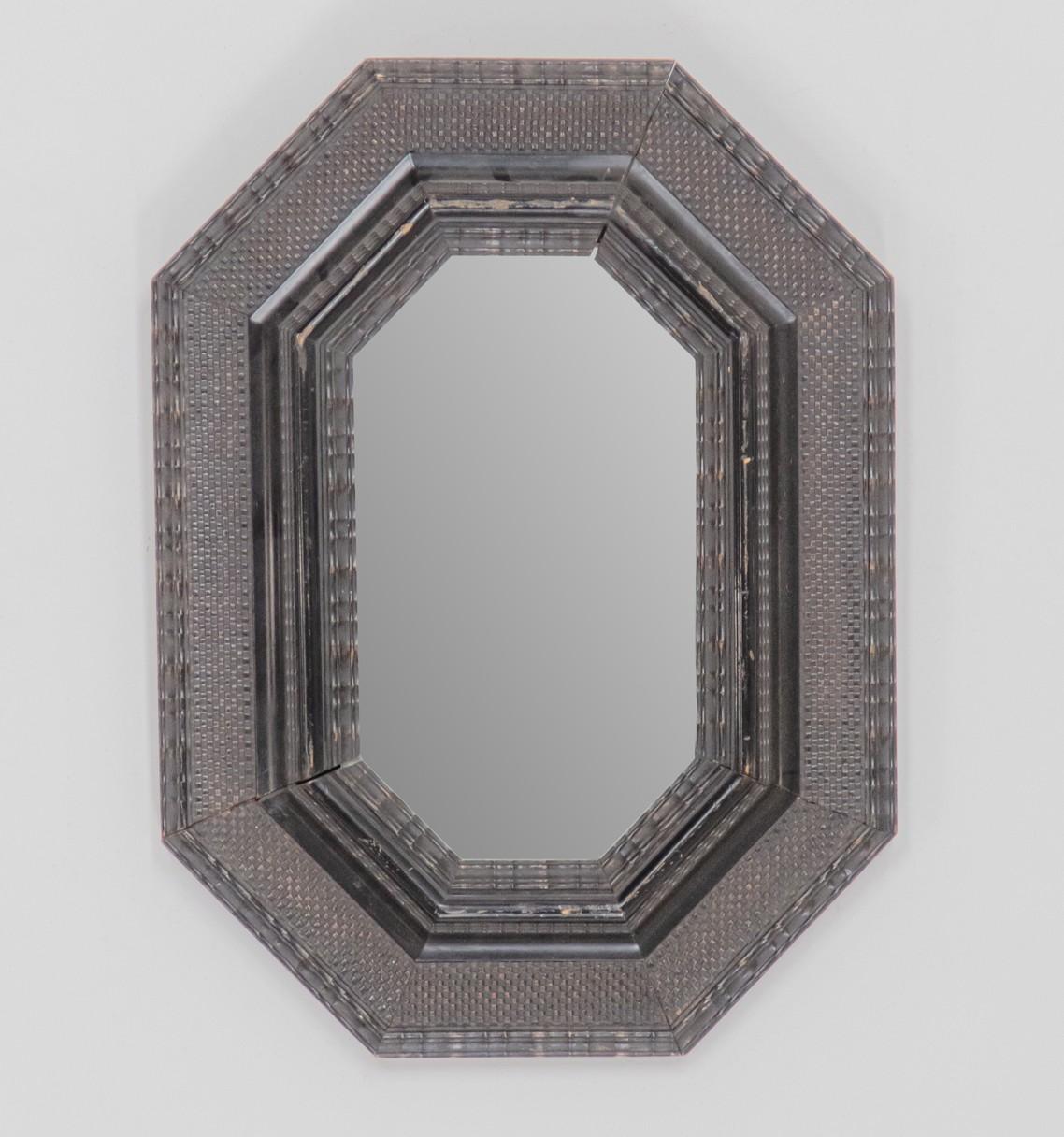 An  early 18th century ebonised mirror, Circa 1730