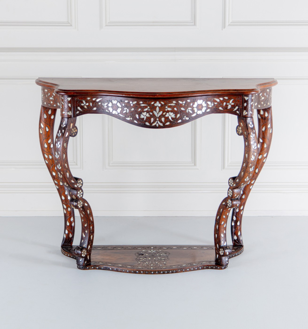 A Moorish mother of pearl and silvered line inlaid serpentine mahogany console table, Circa 1860