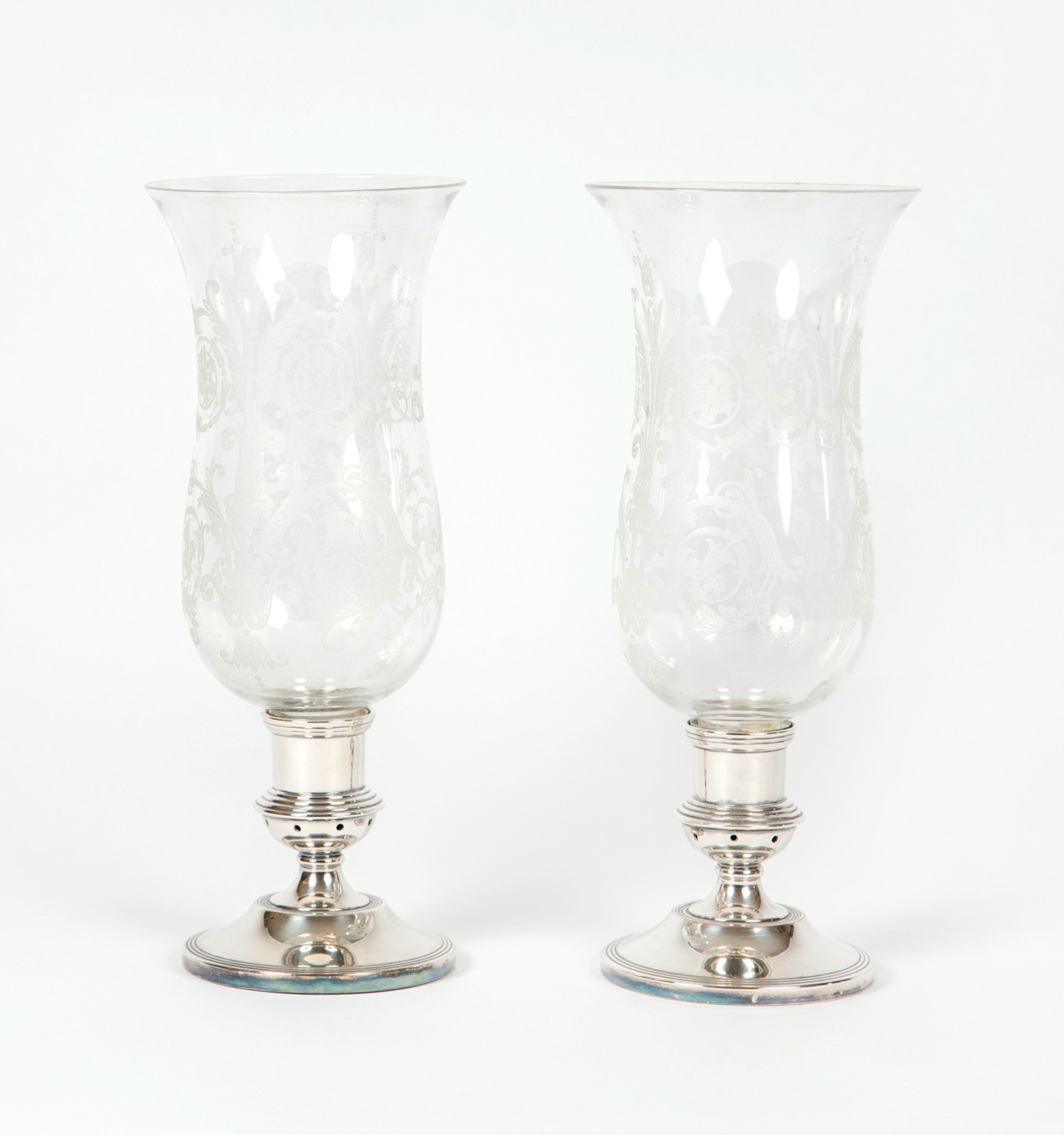 A pair of silver plated and glass stormshades, 20th century