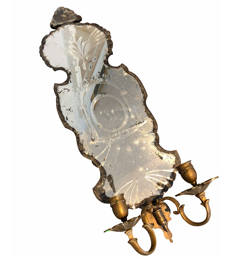 A Cut Glass Mirror with two candle sconces