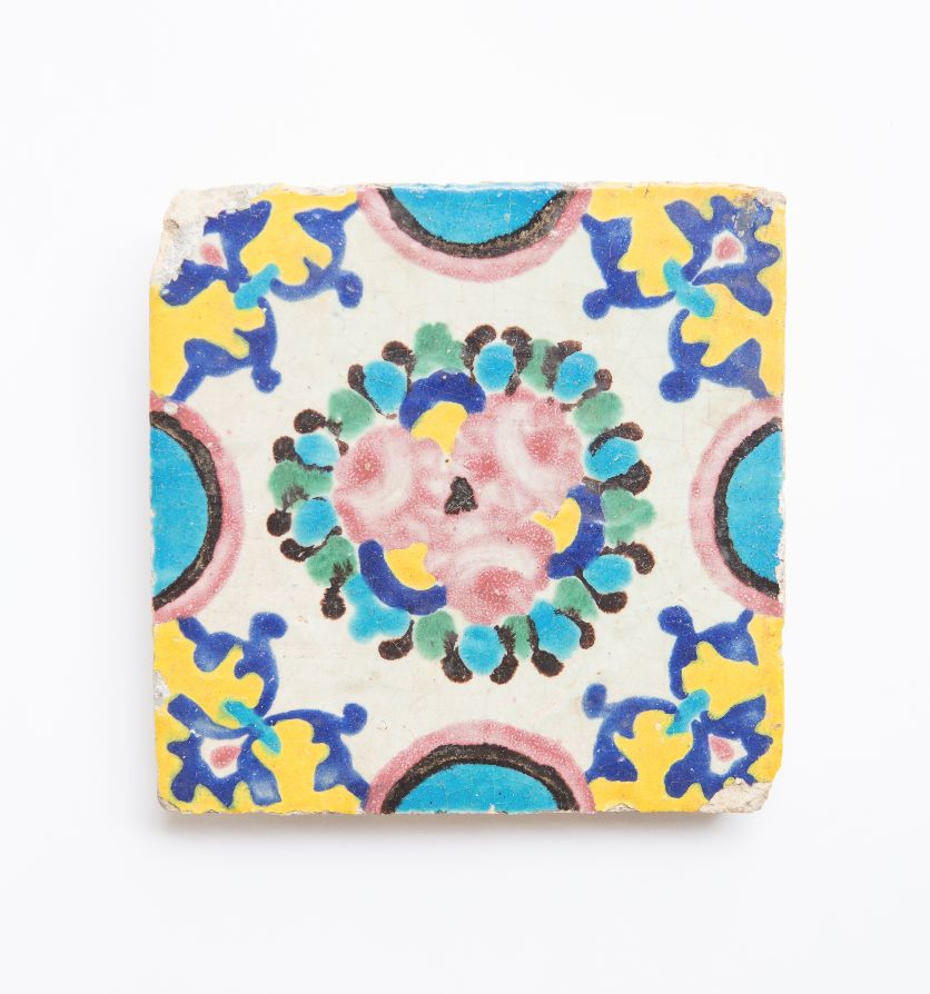 A 19th century decorative tile