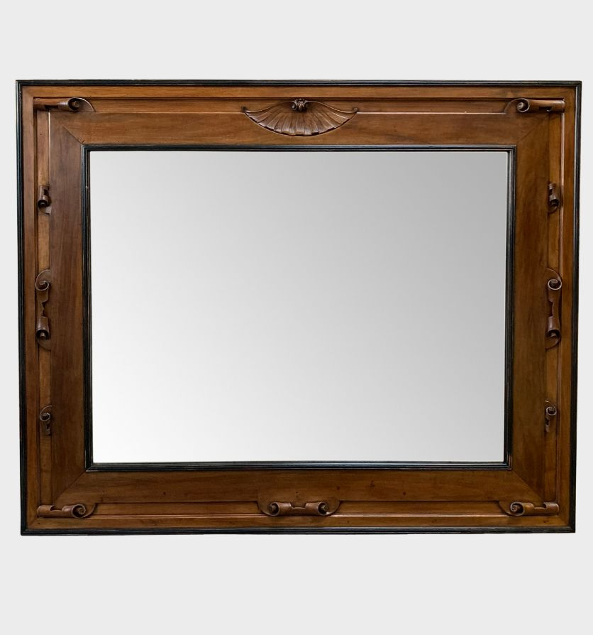 A large 19th century Italian frame with antiqued mirror plate