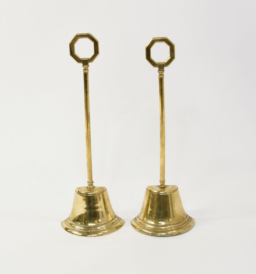 A Georgian pair of brass doorstops