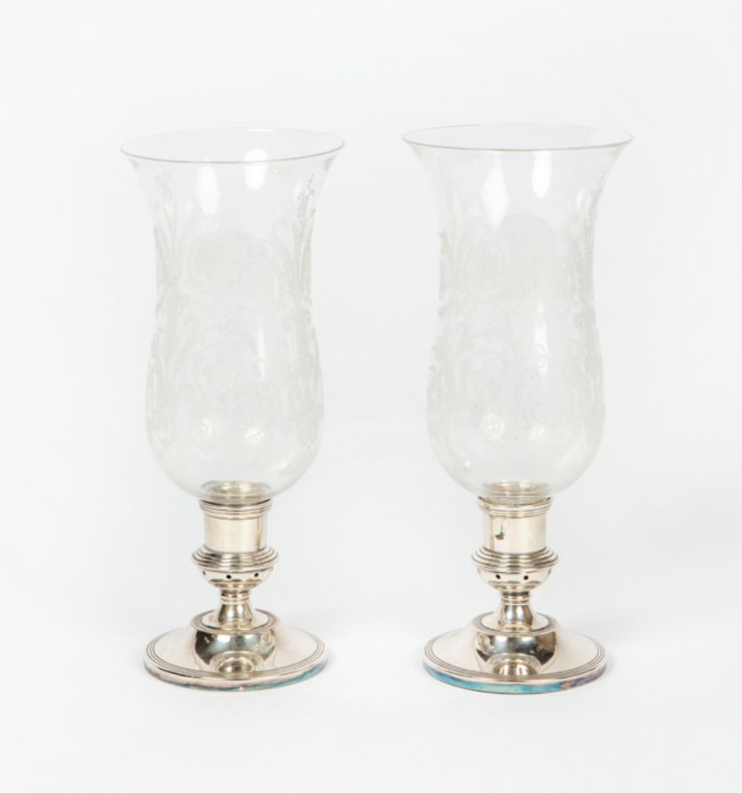 A pair of silver plated and glass stormshades