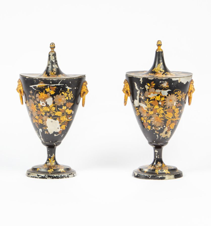 A pair of Regency painted chestnut urns